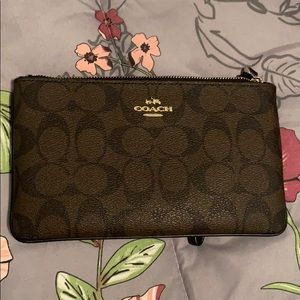 Large authentic COACH wristlet. Never carried.